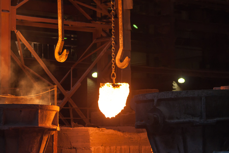smelting plant: Glowing ferroalloy in a metallurgical plant
