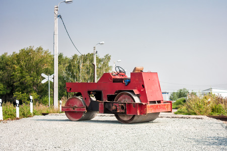 Two-wheel tandem roller at railway crossing