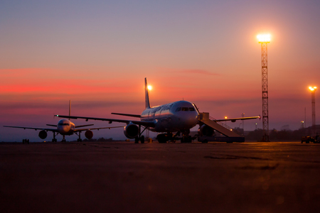 Aircrafts on the airport apron early morning Фото со стока - 69521365