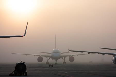 The fog on the airport apron Фото со стока - 67081459