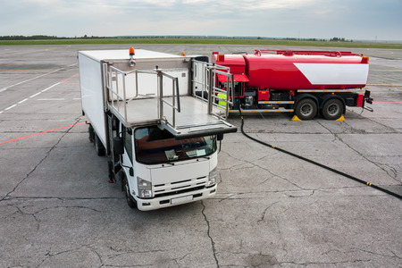 Airport catering truck and refueling truck on apron Фото со стока - 67081467