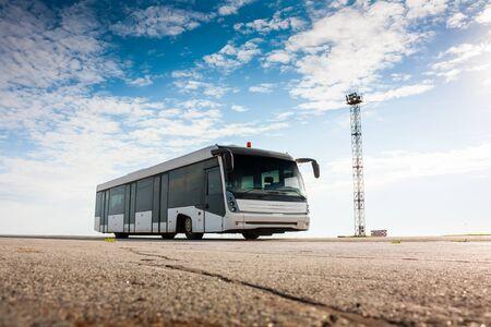Airport bus on the apron Фото со стока - 67643240