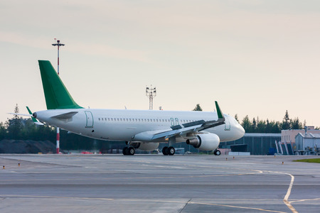 Taxiing aircraft with extended spoilers Фото со стока - 67010780