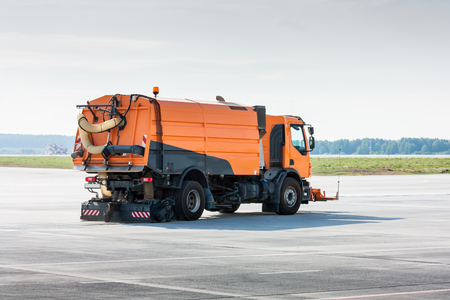 Cleaning the airport apron of the vacuum sweeper truck Фото со стока