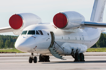 undercarriage: Transport aircraft with open airstair on the airport apron Stock Photo