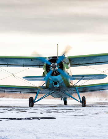 Taxiing single-engine biplane in a cold winter day Фото со стока - 65951447