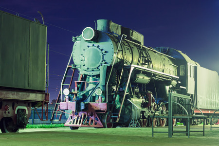 Old steam locomotive at night Фото со стока - 67431086