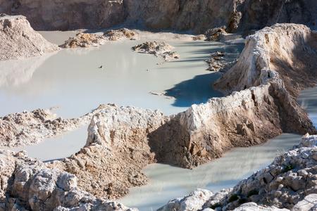 The bottom of the abandoned white clay quarry Фото со стока - 66593940