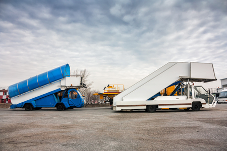 Passenger boarding steps vehicles in the parking airport machinery