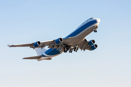 Wide body cargo airplane in the air Stock Photo