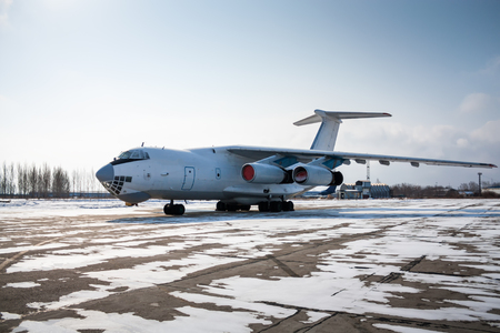 Wide body cargo plane in a cold winter airport