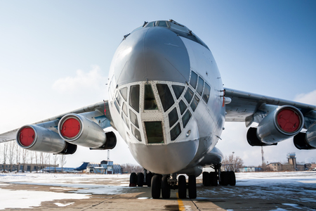 Close-up front view of widebody cargo aircraft in a cold winter airport