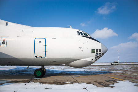 Close-up front view of widebody cargo airplane in a cold winter airport Stock Photo