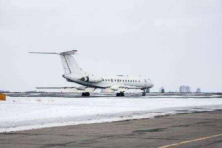 Passenger plane on the winter airport apron Фото со стока