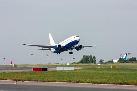 Taking off the passenger plane Stock Photo