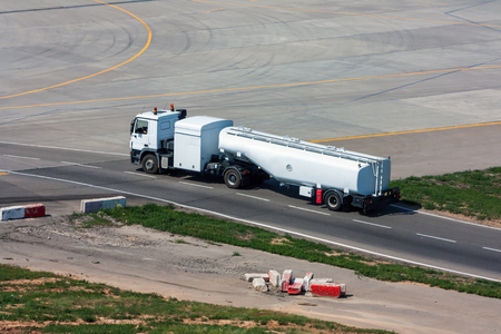 Tank truck aircraft refueler moves on the airport apron Фото со стока