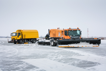 Airfield sweeper-vacuum machine and snowblower universal cleaning truck on the winter runway