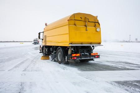 Airfield sweeper-vacuum machines clean Runway