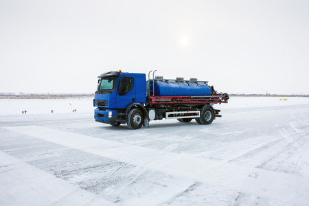 The machine for the distribution of liquid anti-icing reagents on runway Фото со стока