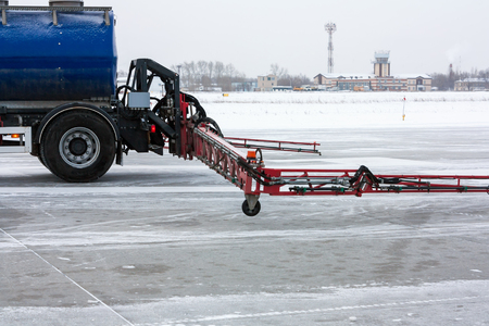 Close-up rear part of the machine for the distribution of liquid anti-icing reagents on runway