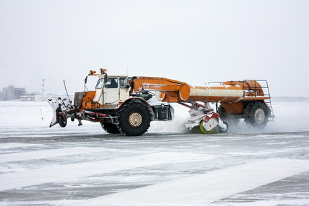 Airfield sweeper cleans the Runway Фото со стока - 93920146