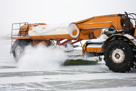 Close-up airfield sweeper on the runway