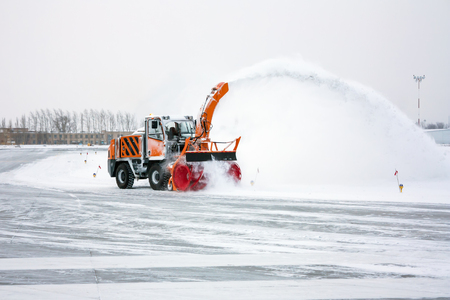 Snow blower cleans taxiway Фото со стока - 93888538