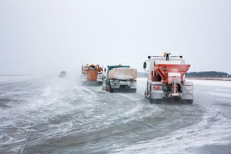Snowplows cleans the runway Фото со стока - 93880995