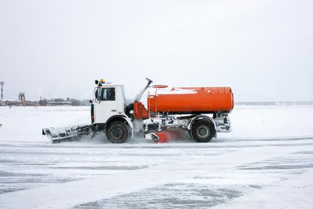 Snow machine at the airport Stock Photo
