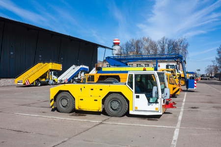 Tow tractors, passenger boarding steps vehicles and other airport machinery