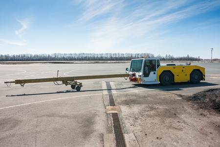 Aircraft tow truck with towbar on the airport apron Фото со стока