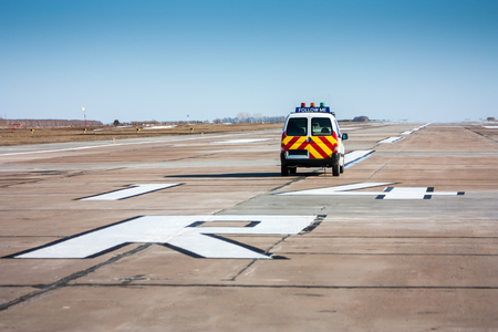 Follow me car at the airport runway Фото со стока - 93867648
