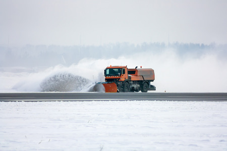 Snow-removal machine cleans the runway at the airport Фото со стока - 94822935