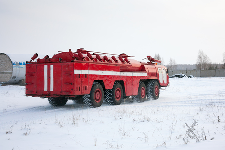 Airfield firetruck in the cold winter airport Фото со стока - 95072851