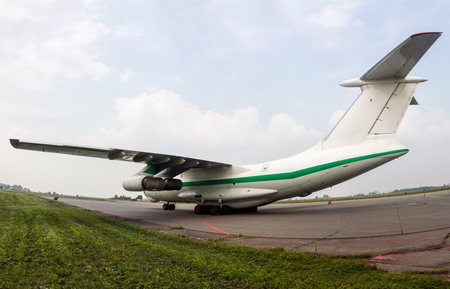 Big freight airplane at the cargo parking on the airport apron