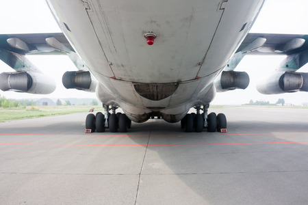 Rear view of main landing gear and cargo hatch of big wide body aircraft