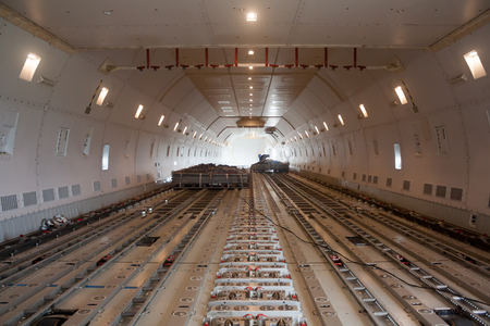Inside wide body air cargo freighter. A lower deck Фото со стока