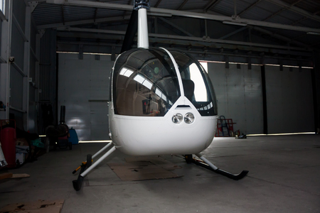 Small helicopter in the hangar. Front view