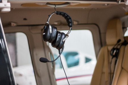 Headphones with a microphone in the helicopter cabin Фото со стока