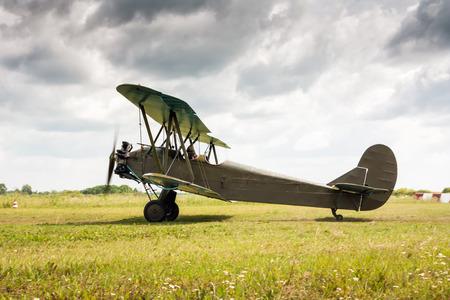 Retro airplane is preparing to take off Фото со стока