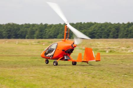 Takeoff of gyroplane Фото со стока