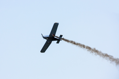 A small sports plane is burning in the air Stock Photo