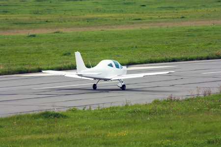 Small sports airplane on the runway