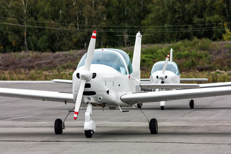 Small sports aircraft in the parking lot of the airfield Фото со стока