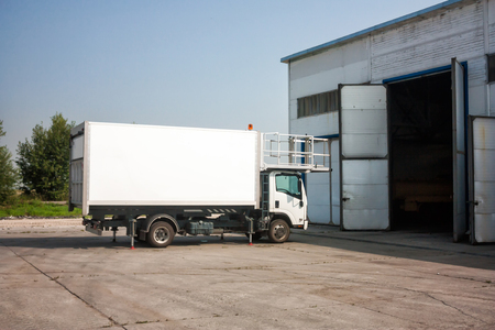 Airport catering truck near garage boxes Фото со стока