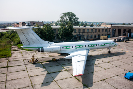 Repair and maintenance of passenger airplane on the aviation technical base Фото со стока