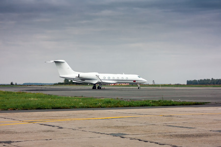 Business jet at the airport apron
