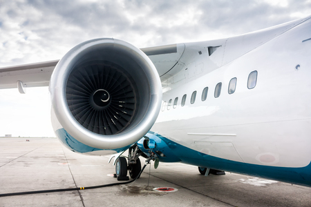 Close-up of the engine and fuselage of a passenger aircraft