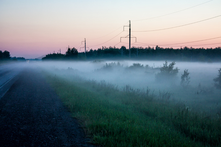 Ground fog near the road at sunset
