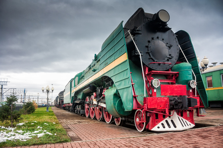 Old steam locomotives on the station platform Фото со стока